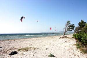 Kitesurfing in Chia, Sardinia, with the winds blowing from east.