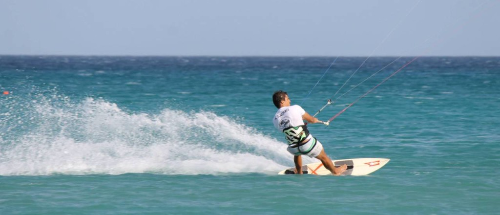 Kitesurfing with a surfboard
